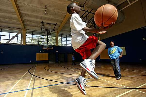 12-year-old Tyrese Johnson, (left) and 11-year-old Ivory Bivins shoot hoops on Monday May, 11, 2010, they are part of an after school program at Hamilton Recreation Center Mayor Gavin Newsom, at the Hamilton Recreation Center in San Francisco, Calif., announced today that the city is expanding summer youth programs to help make up for the decline in the San Francisco Unified School District's summer programs as a result of state budget cuts.