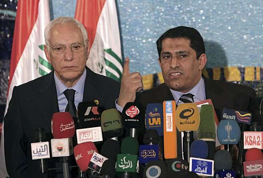 Mohammed al-Khamlishi, Arab League envoy to Iraq, left, Qassim al-Aboudi, a senior official with Iraq's High Electoral Commission , right, appear at a press conference in Baghdad, Iraq, Sunday, May 16, 2010. A recount of votes cast in Baghdad did not change the results of Iraq's March election, an electoral official said Sunday, preserving a narrow victory for the Sunni-backed candidate over the Shiite prime minister. Photo: Khalid Mohammed, AP