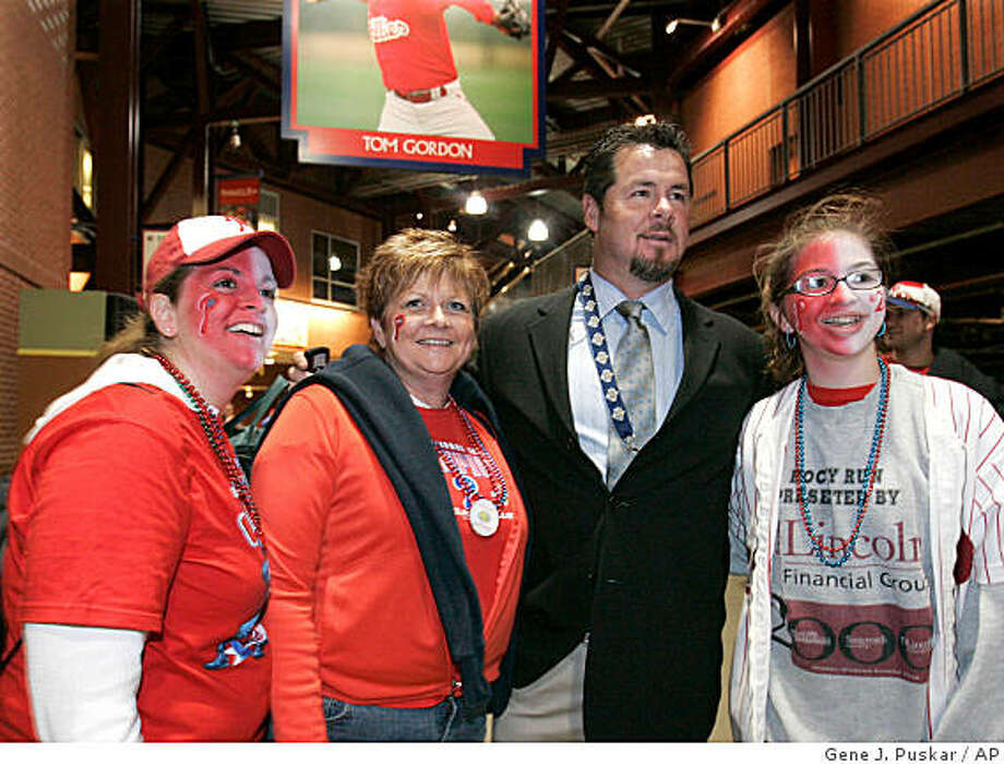 Former Philadelphia Phillies pitcher Mitch Williams poses with fans in Citizens Bank Park before Game 4 of the World Series between the Philadelphia Phillies and Tampa Bay Rays in Philadelphia, Sunday, Oct. 26, 2008. Photo: Gene J. Puskar, AP