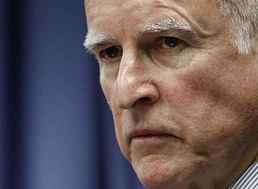 Attorney General Jerry Brown listens to a reporters question concerning the lawsuit his office has filed against two former officials of CalPERS, the nation's largest public pension fund, for fraud during a news conference in Sacramento, Calif., Thursday,May 6, 2010. The lawsuit, which was filed Wednesday in Los Angeles County Superior Court. alleges that former CalPERS Chief Executive Federico Buenrostro Jr. and former CalPers board member Alfred Villalobos were involved in a system of kickbacks in exchange for outside firms winning a piece of the fund's lucrative investment portfolio.