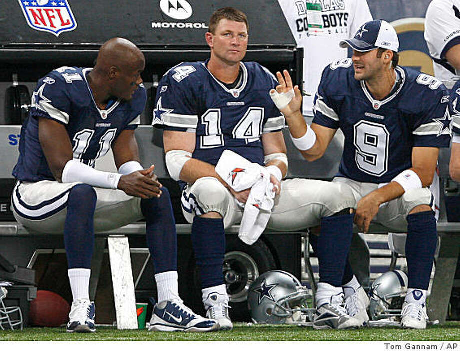 Dallas Cowboys quarterback Brad Johnson (14) sits on the bench between teammates, injured quarterback Tony Romo, right, and wide receiver Roy E. Williams, left, during the second quarter of an NFL football game against the St. Louis Rams Sunday, Oct. 19, 2008, in St. Louis. (AP Photo/Tom Gannam) Photo: Tom Gannam, AP