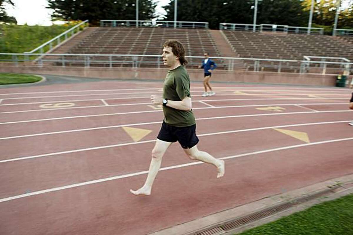 Shawn Davenport of San Francisco, runs at Kezar Stadium on Wednesday, May 5, 2010, in San Francisco, Calif. Davenport started a new barefoot running club, part of a larger trend of athletes who are doing away with expensive shoes in order to have a better running experience.