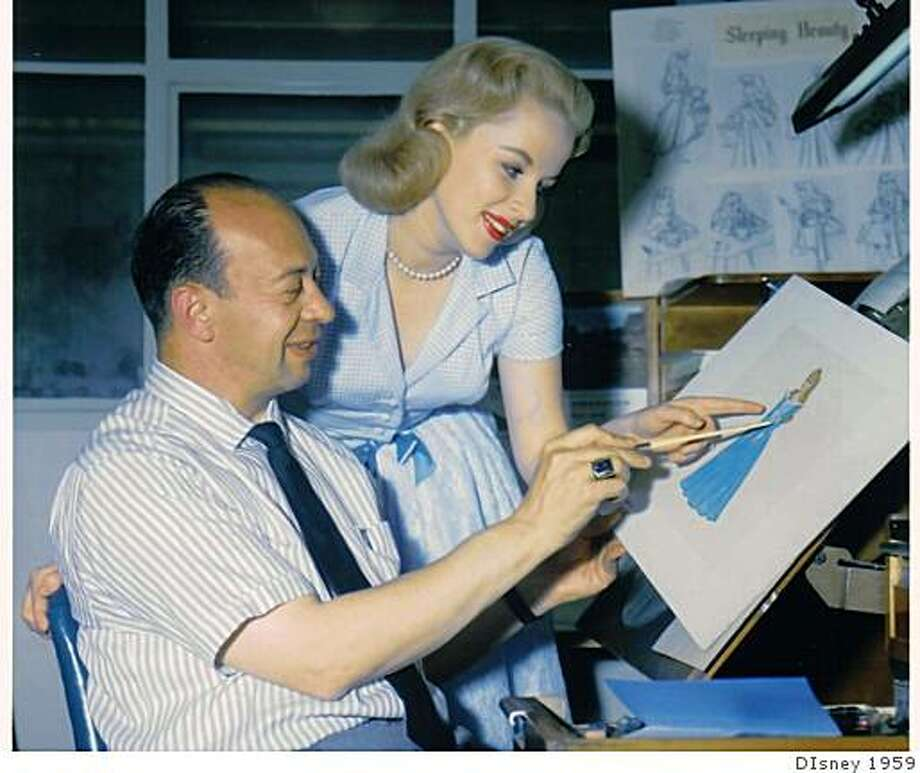 "Above: Animating director Marc Davis and Mary Costa, the voice of Princess Aurora, look at a sketch in the early stages of making Walt Disney's ""Sleeping Beauty."" Photo: DIsney 1959"