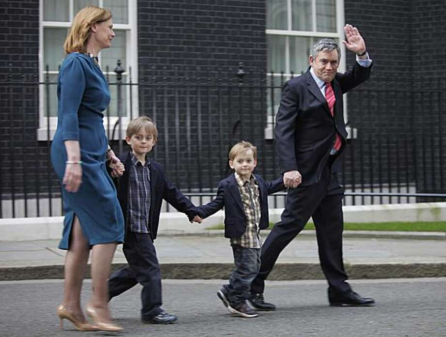 Britain's Prime Minister Gordon Brown, right, accompanied by his wife Sarah, left, and their children, John, 2nd right, and Fraser, leave his official residence at No.10 Downing Street in central London, after he announced his resignation, Tuesday May 11,2010. Photo: Lefteris Pitarakis, AP