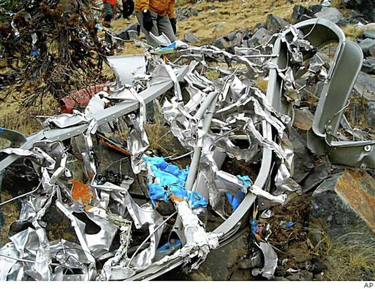 This Friday, Oct. 3, 2008 picture provided by the Madera County Sheriff's Department shows wreckage from the fuselage from Steve Fossett's plane near Mammoth Lakes, Calif. Searchers have found what appear to be two large human bones near the crash site of Fossett's plane in California's Sierra Nevada, along with the adventurer's tennis shoes and driver's license, authorities said Thursday, Oct. 30, 2008. (AP Photo/Madera County Sheriff's Department)
