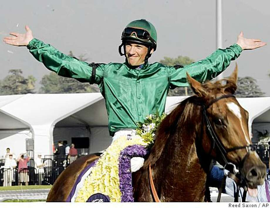 Jockey Frankie Dettori celebrates aboard Raven's Pass after winning the Breeders' Cup Classic at Anita Park in Arcadia, Calif., Saturday, Oct. 25, 2008. Photo: Reed Saxon, AP