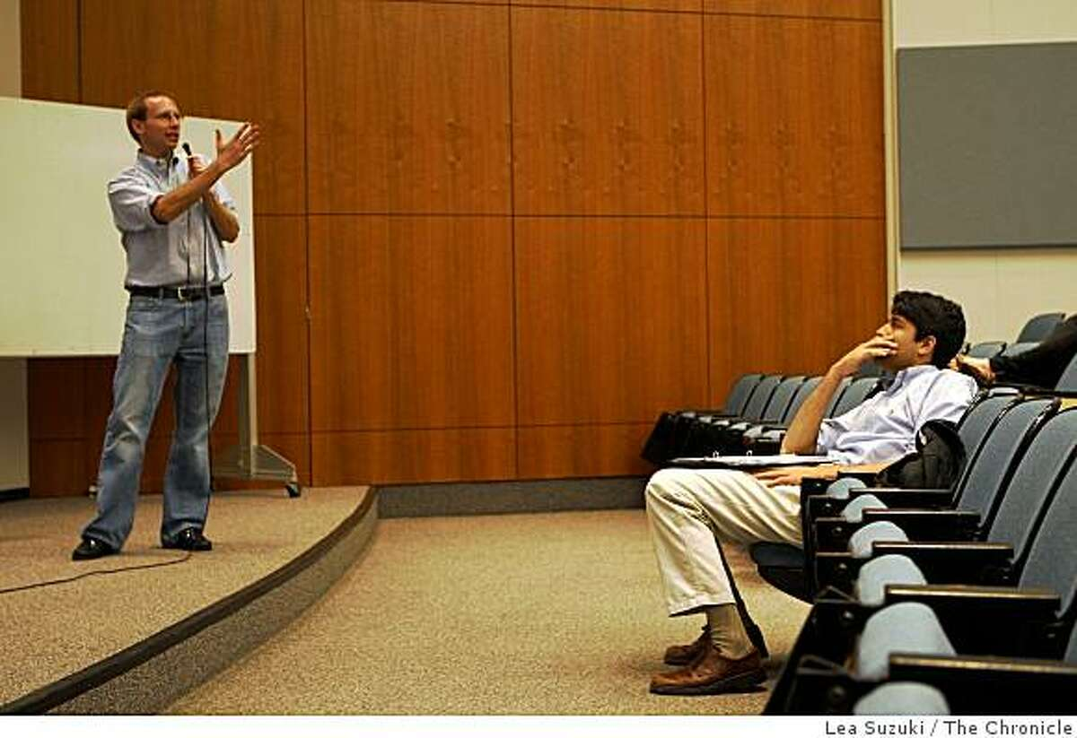 Blair Nathan (right), Stanford junior, listens as Stanford professor Alex Gould (left) lectures during a banking and finance class in the Annenberg Auditorium on Wednesday, October 15, 2008 in Stanford, Calif.