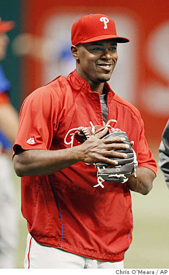 Philadelphia Phillies' Jimmy Rollins, left, and catcher Carlos Ruiz are seen during a workout at Tropicana Field Tuesday, Oct. 21, 2008, in St. Petersburg, Fla. The Phillies will meet the Tampa Bay Rays in Game 1 of the World Series on Wednesday, Oct. 22. (AP Photo/Chris O'Meara) Photo: Chris O'Meara, AP