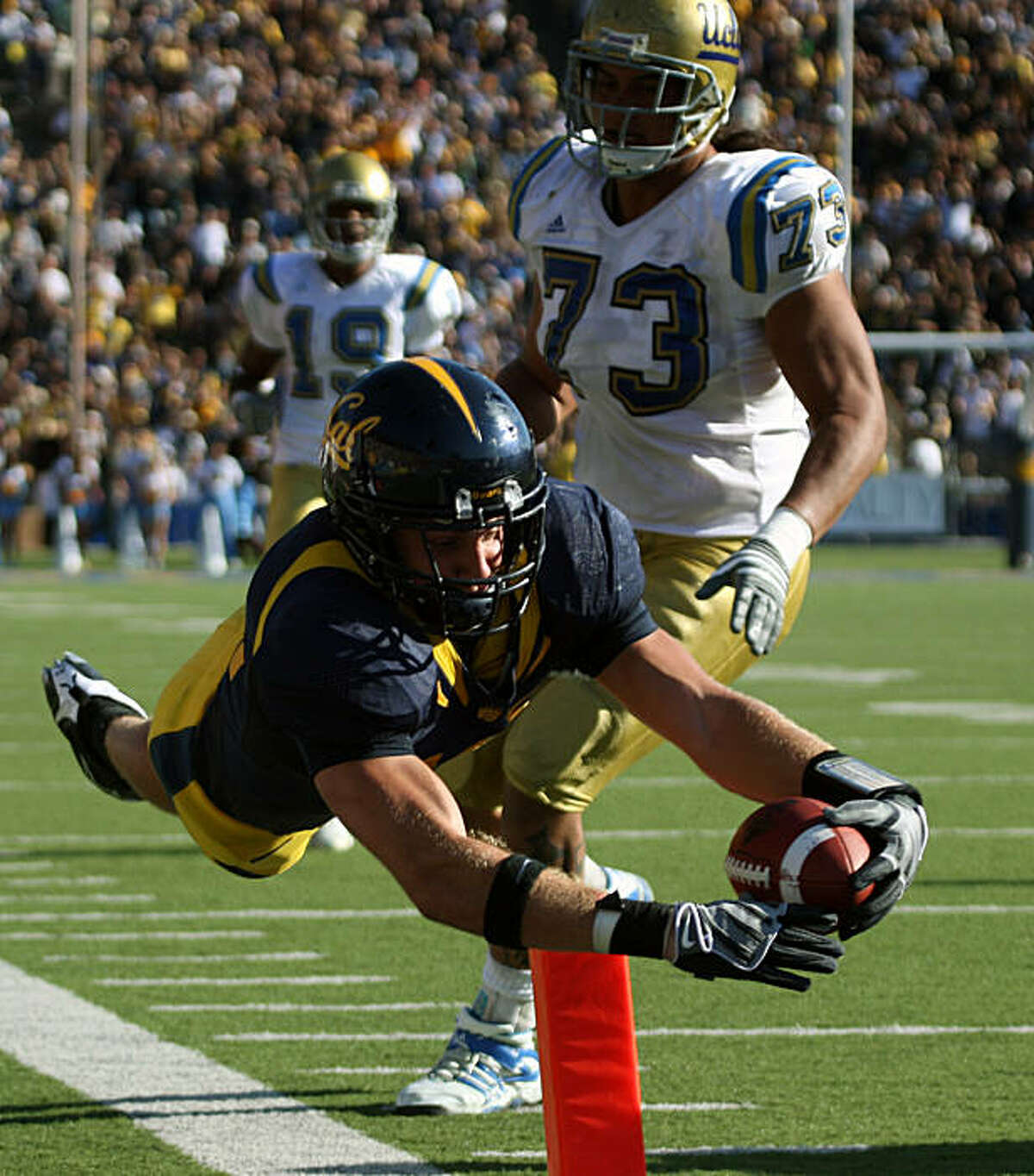 Cal linebacker Michael Mohamed dives into the end zone after intercepting a UCLA pass from Kevin Craft in the 4th quarter of the Bears 41-20 victory over UCLA in Berkeley, Calif., on Saturday, October 25, 2008.