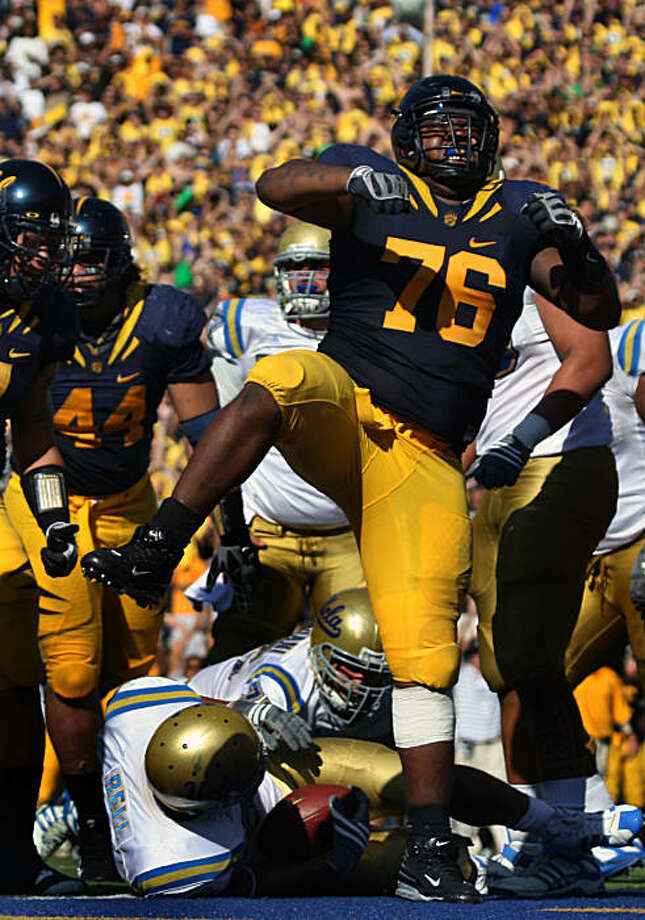 Derrick Hill celebrates after the Cal defense stopped UCLA tail back Khalil Bell inside the one-yard line forcing a punt in the third quarter. The Cal Bears outscored the UCLA Bruins 41-20 in the victory in Berkeley, Calif., on Saturday, October 25, 2008. Photo: Lance Iversen, The Chronicle