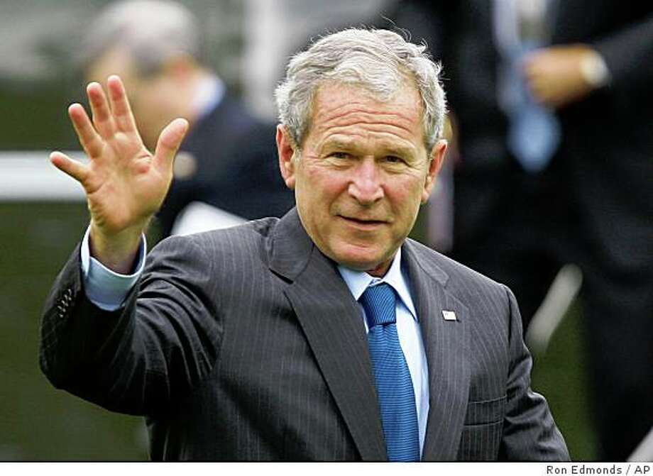 President Bush waves upon his return to the White House in Washington, Friday, Oct. 24, 2008, after a trip to attend briefings at the National Security Agency at Fort Meade, Md.  (AP Photo/Ron Edmonds) Photo: Ron Edmonds, AP