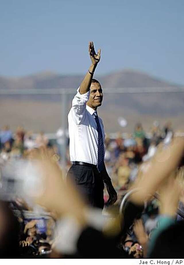 Democratic presidential candidate, Sen. Barack Obama, D-Ill., waves after speaking at a rally in Reno, Nev., Saturday, Oct. 25, 2008. (AP Photo/Jae C. Hong) Photo: Jae C. Hong, AP