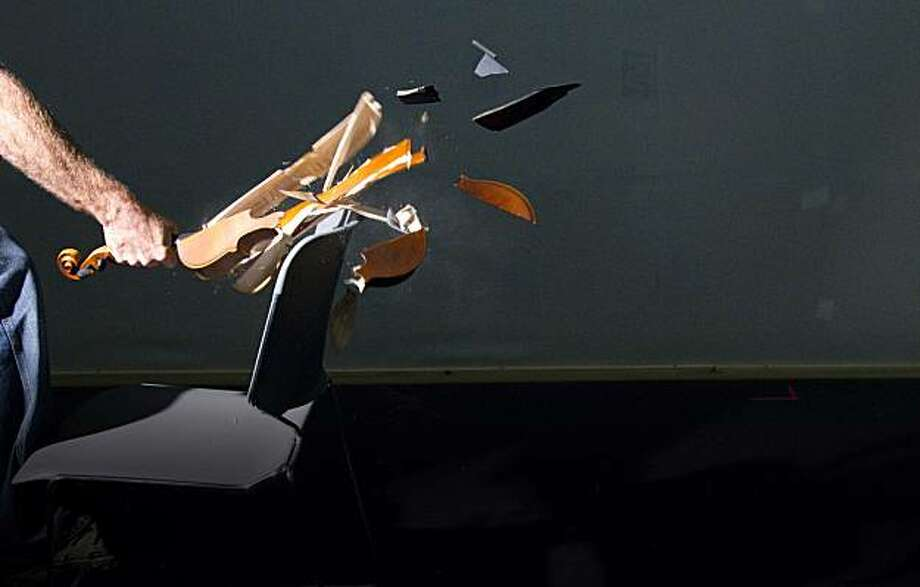 """A violin getting smashed in TheatreWorks """"Opus"""" Photo: Mark Kitaoka"""