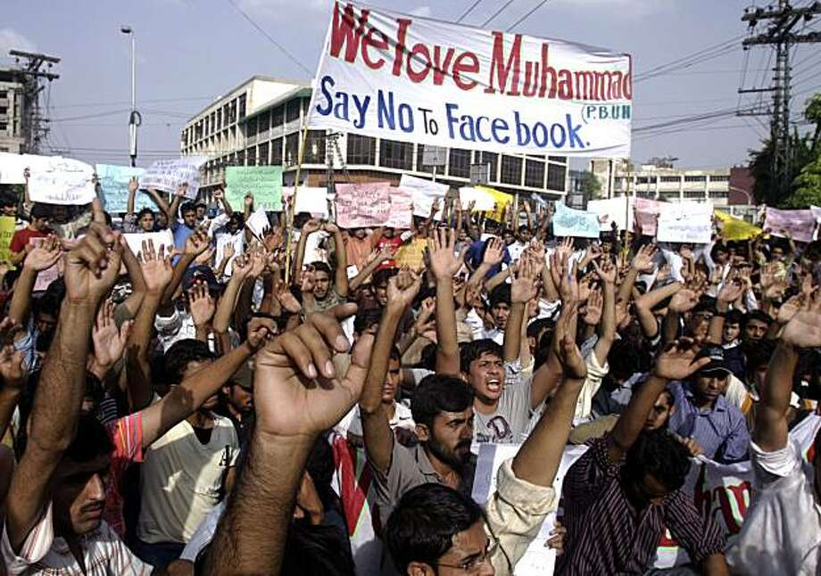 Pakistani students chant slogans during a rally against Facebook page amid anger over a page which encourages users to post images of Islam's Prophet Muhammad,  in Lahore, Pakistan, on Wednesday, May 19, 2010.  A Pakistani court ordered the government toblock the popular social networking website Facebook temporarily because of a controversial page that encourages uses to submit images of Islam's Prophet Muhammad, a senior legal official said. Photo: K.M. Chaudary, AP