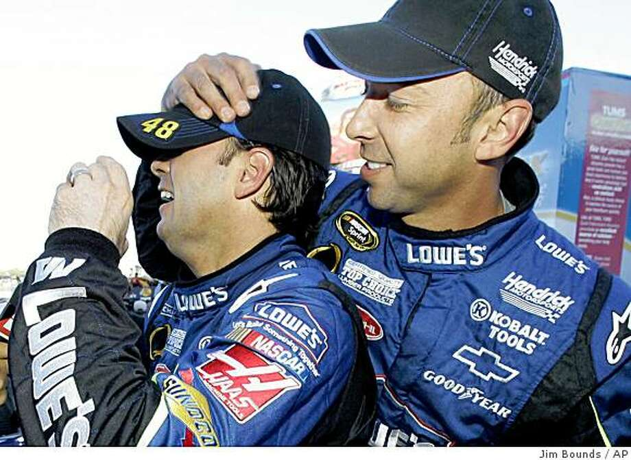 Jimmie Johnson, left, and Chad Knaus have been together since the driver became a regular in Sprint Cup in 2002 with Hendrick Motorsports. The pairing is also one of the most successful marriages of stock car talent ever as they close in on a record-tying third consecutive Cup championship. Photo: Jim Bounds, AP