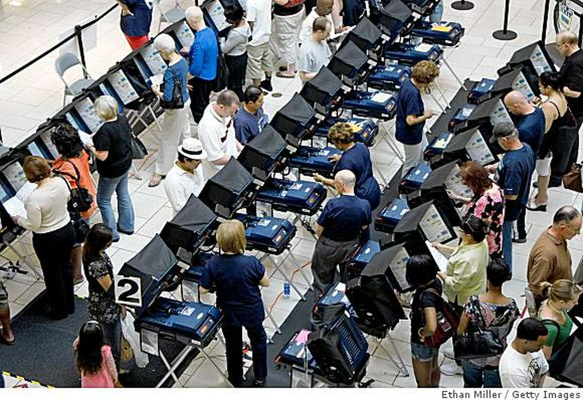 LAS VEGAS - OCTOBER 29: People vote early at the Meadows Mall October 29, 2008 in Las Vegas, Nevada. As of October 28, more than 32% of the Nevada electorate had cast their ballots ahead of the November 4 general election. (Photo by Ethan Miller/Getty Images)