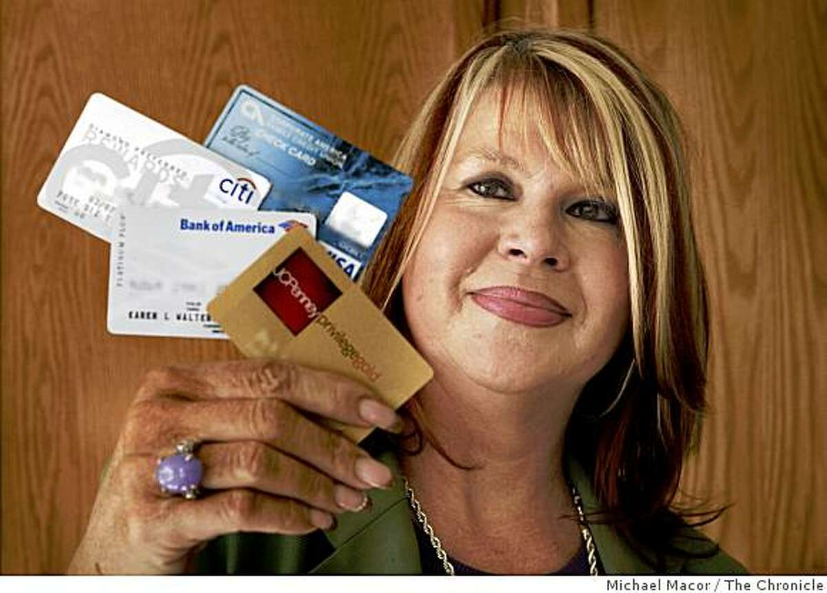 Karen Walters is the face of an american public that has grown increasingly irrate with unexpected credit card increases such as her Bank of America Visa card which went from a 0% to a 28.99% interest rate. Walters in her Redwood Shores, Calif. home, on Friday Oct. 24, 2008