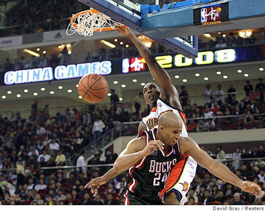 DeMarcus Nelson (top) scores over Richard Jefferson of the Milwaukee Bucks during the fourth quarter of their preseason exhibition game at the Beijing Olympic Basketball Arena October 18, 2008. Photo: David Gray, Reuters