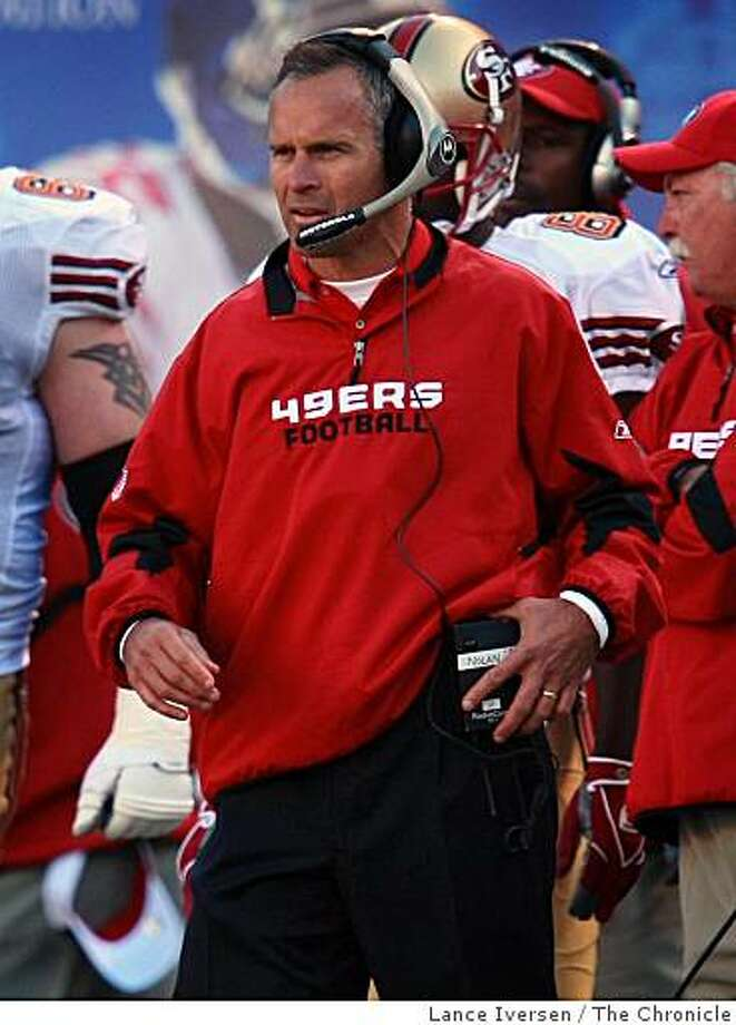 49ers Head coach Mike Nolan talks with his assistant coaches up stairs in the press box as he walks the sidelines as the clock runs down to the two minute warning Sunday October 19, 2008 in New York NY.  The New York Giants defeated the San Francisco Giants 29-17 Photo: Lance Iversen, The Chronicle