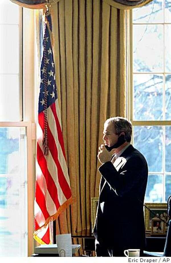 President Bush talks on the phone in the Oval Office of the White House, Thursday, Jan. 25, 2001. Photo: Eric Draper, AP