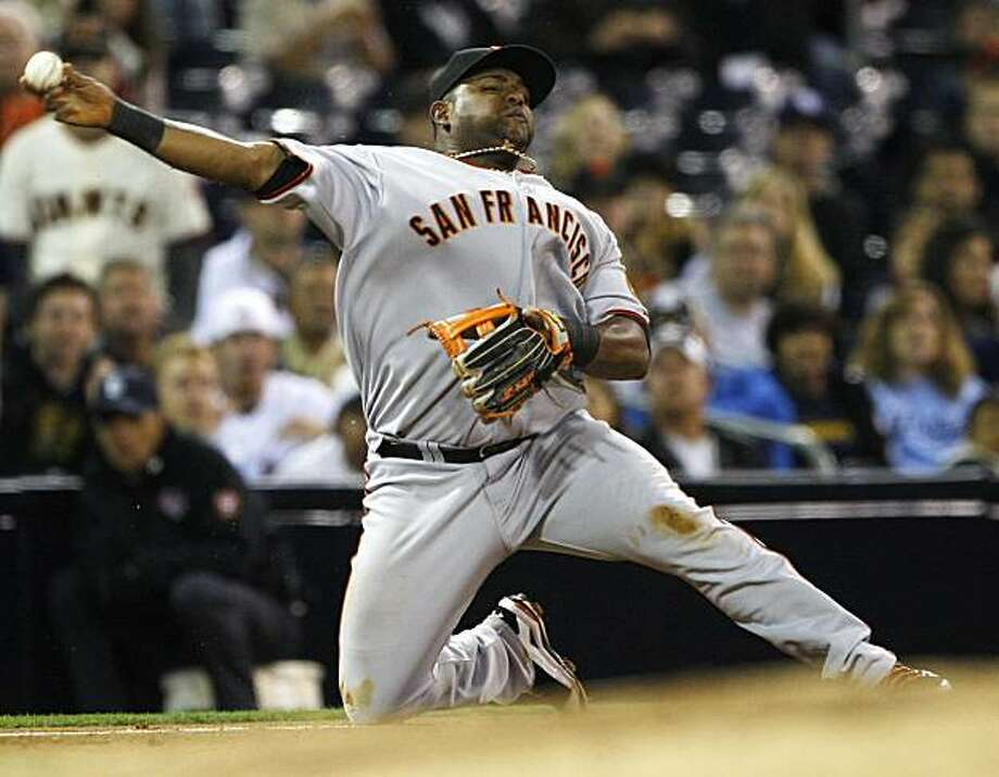 San Francisco Giants third baseman Pablo Sandoval tries to throw out San Diego Padres' David Eckstein from his knees after knocking down a hard grounder in the fifth inning Monday in San Diego. Eckstein was safe at first and scored later on a single by Chase Headley. Photo: Lenny Ignelzi, AP