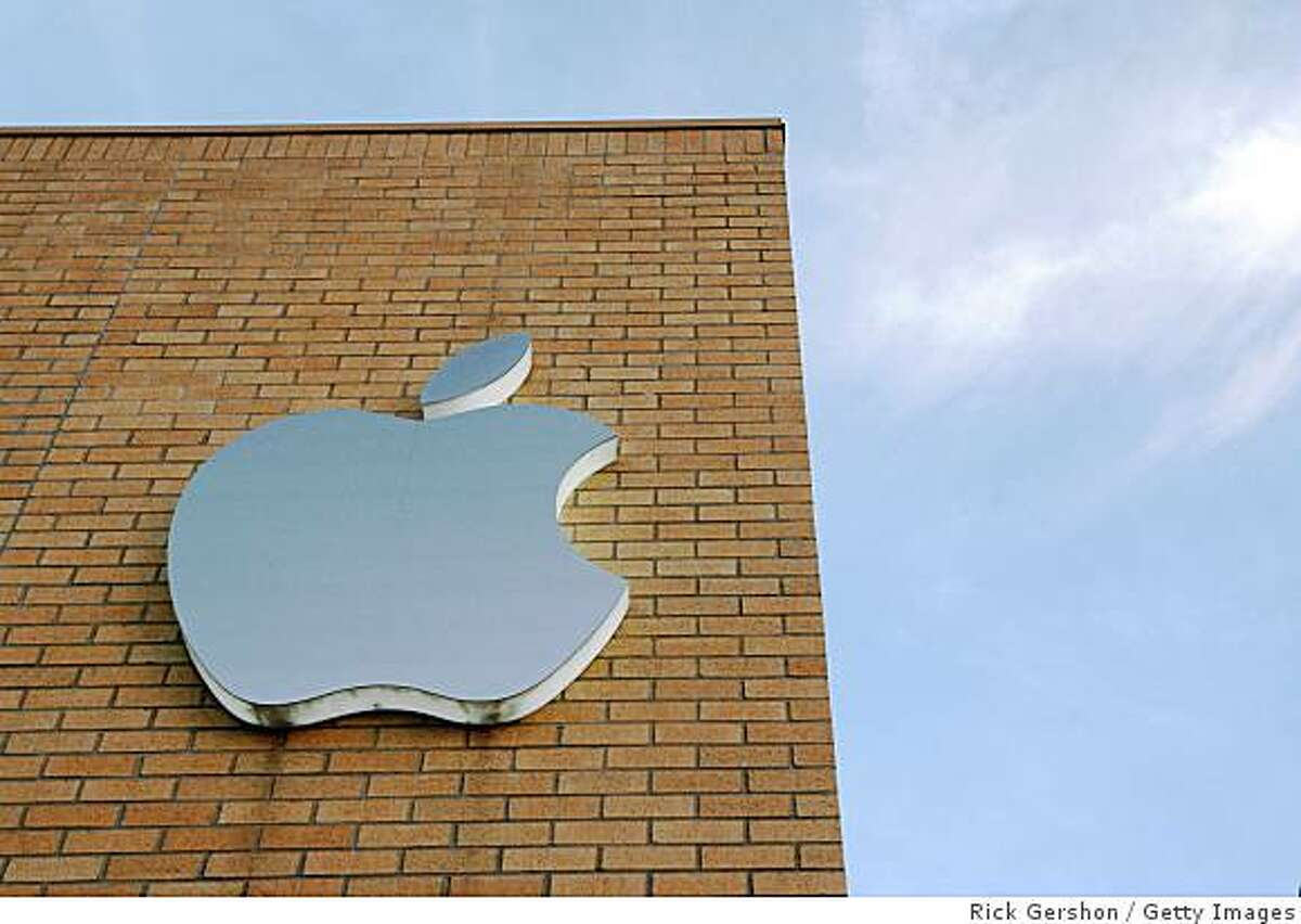 DALLAS - JULY 11: (FILE PHOTO) The Apple logo is illuminated on the side of the Apple Store at daybreak July 11, in Dallas, Texas. Apple announced a 26 percent profit increase in the last quarter, much of which can be attributed to iPhone sales. (Photo by Rick Gershon/Getty Images)