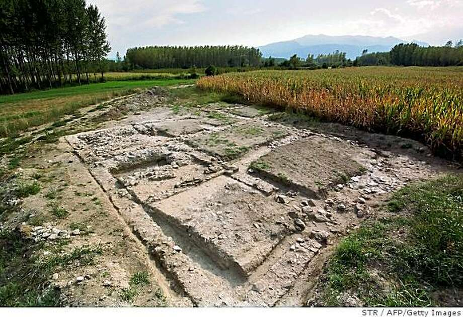 A handout photo given by the Greek Culture Ministry on October 23, 2008 shows the remains of a rare Stone Age homestead left undisturbed for nearly 6,000 years. The building was destroyed in a fire but its residents had the time to flee taking most of their valuable stone tools with them, the ministry said. Instead, archaeologists found a large number of clay vessels, millstones, some tools and two home furnaces. The rectangular 58-square-metre building was built in the fourth millennium BCE. It stood on stilts and its wooden frame was filled with a mixture of branches and reeds covered in clay.              AFP PHOTO / HANDOUT / Greek Culture Ministry (Photo credit should read STR/AFP/Getty Images) Photo: STR, AFP/Getty Images