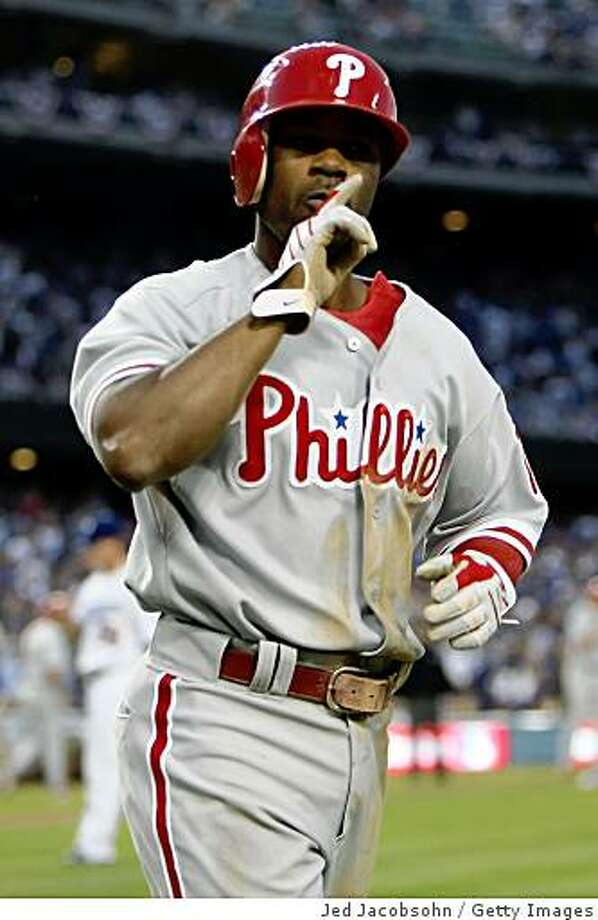 LOS ANGELES, CA - OCTOBER 15:  Jimmy Rollins #11 of the Philadelphia Phillies celebrates after scoring in the third inning against the Los Angeles Dodgers in Game Five of the National League Championship Series during the 2008 MLB playoffs on October 15, 2008 at Dodger Stadium in Los Angeles, California.  (Photo by Jed Jacobsohn/Getty Images) Photo: Getty Images