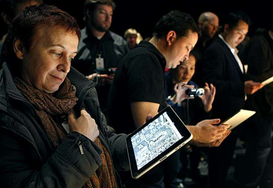 Swiss journalist Marie Crivelli is one of the first tech writers to try out the new iPad after Apple CEO Steve Jobs unveiled the tablet-style gadget at the Yerba Buena Center for the Arts. Photo: Paul Chinn, The Chronicle