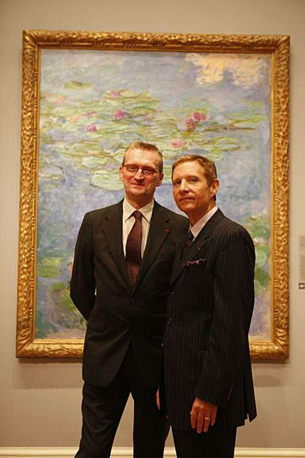 "Guy Cogeval, President of the Musee d'Orsay, and John Buchanan meet for a portrait in front of Monet's ""Watter Lilies"" at the museum on Friday July 31, 2009 in San Francisco, Calif. Photo: Mike Kepka, The Chronicle"