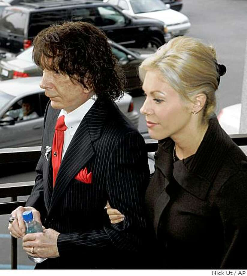 Music producer Phil Spector, left, and his wife Rachelle Spector arrive at Los Angeles County Superior Court Monday, Oct. 20, 2008, for the start of jury selection in his murder re-trial. Spector is charged with second-degree murder in the 2003 death of actress Lana Clarkson, 40, at his Alhambra mansion. (AP Photo/Nick Ut) Photo: Nick Ut, AP