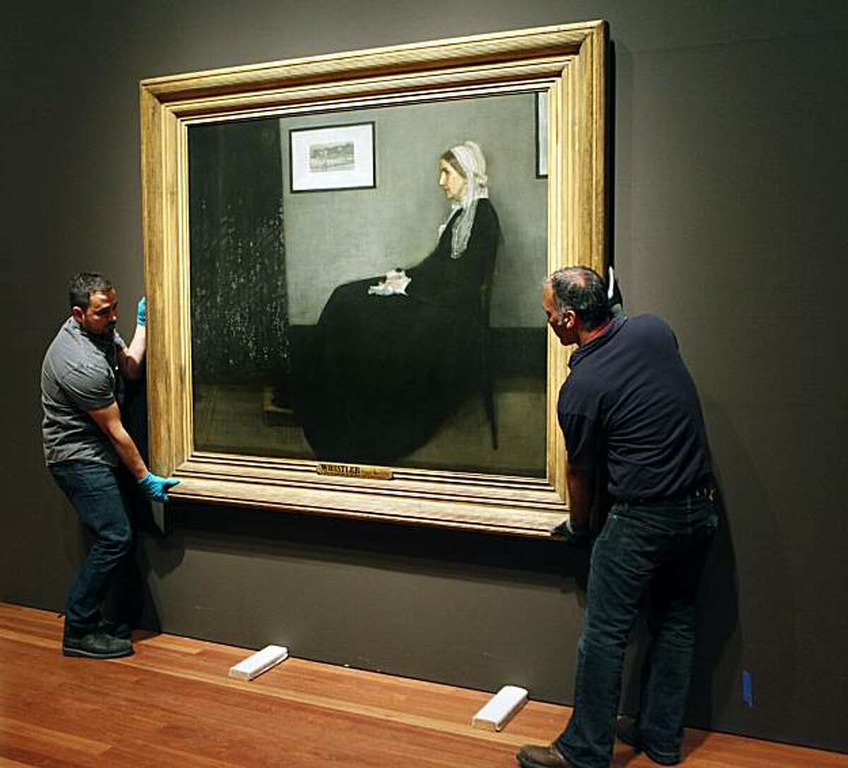 The De Young Museum employees install Whistlers Mother by James McNeill Whistler painted in 1871. The De Young Museum will unveil it's newsiest show May 22nd
