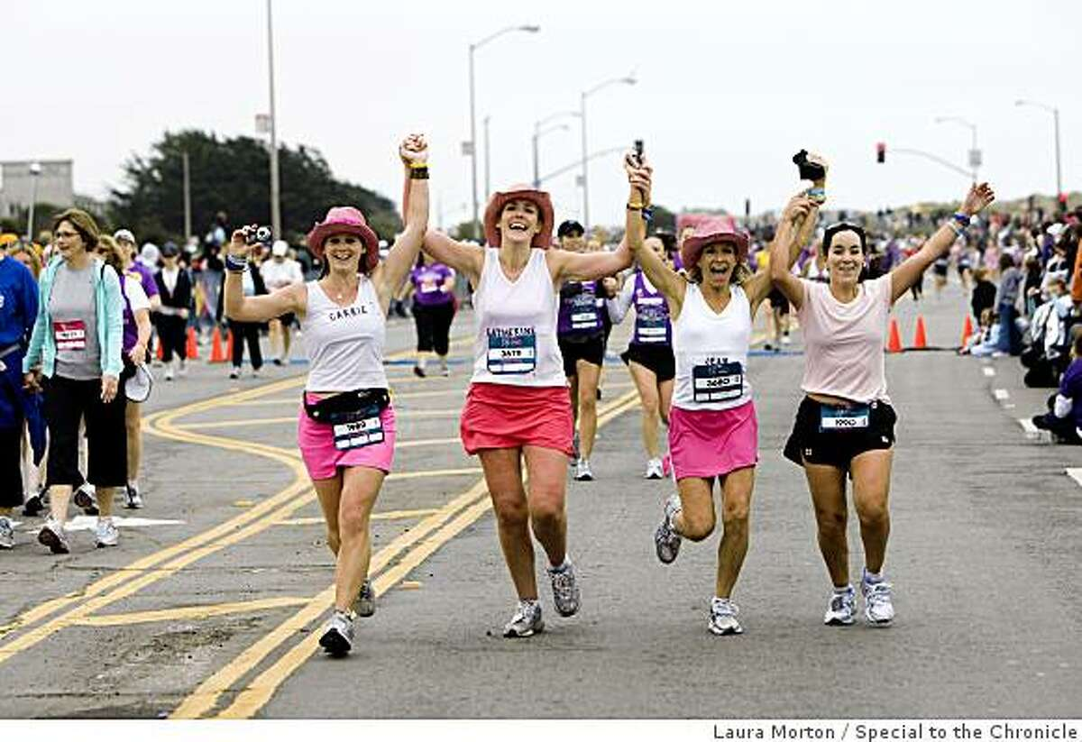 Four friends dressed as cowgirls head towards the finish line of the Nike Women's Marathon in San Francisco, Calif., on Sunday, October 19, 2008.
