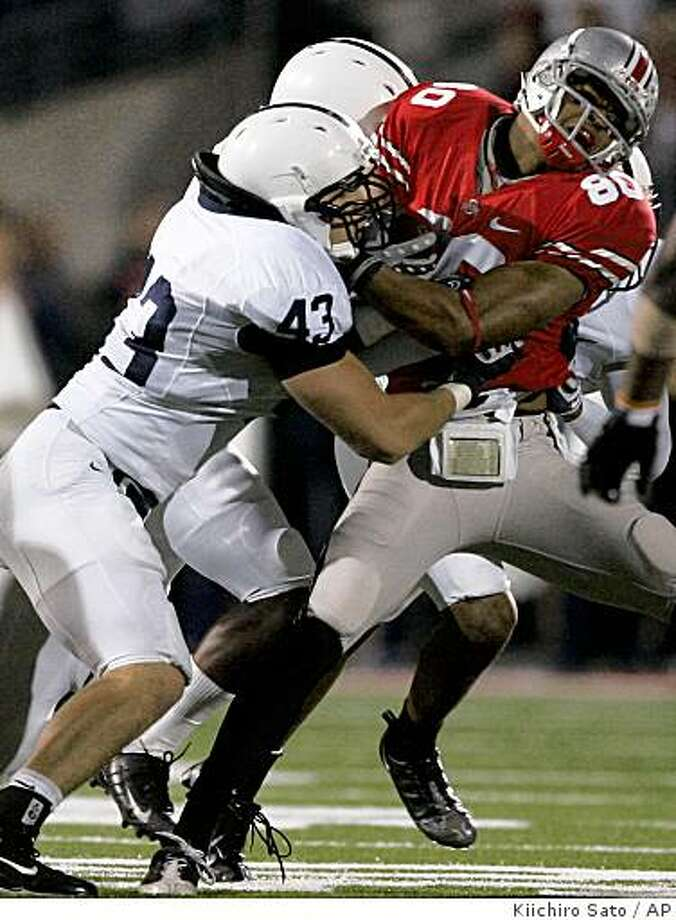 Ohio State wide receiver Brian Robiskie (80) gets pushed back after a reception by Penn State defense during the second quarter of an NCAA college football game Saturday, Oct. 25, 2008 in Columbus, Ohio.  (AP Photo/Kiichiro Sato) Photo: Kiichiro Sato, AP