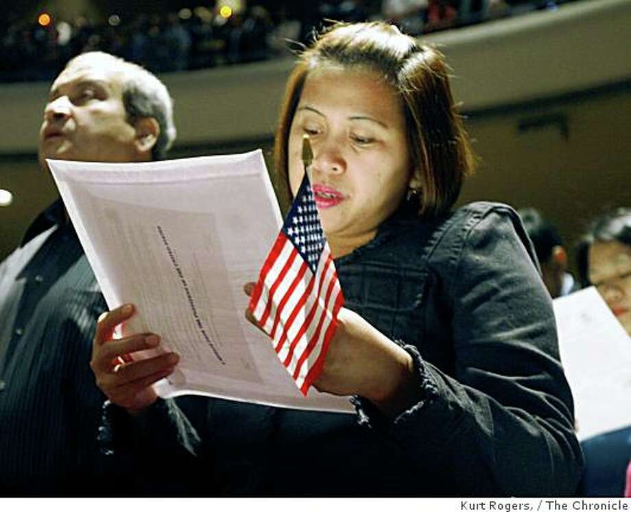 Connie Santos, from the Philippines, who now lives in Hayward, sings the national anthem during in a mass naturalization ceremony held at the Masonic Auditorium, on Tuesday, Aug 26  2008 in San Francisco , Calif Photo: Kurt Rogers,, The Chronicle