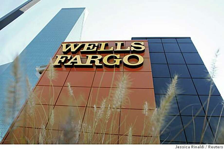 A Wells Fargo bank is pictured in Dallas, Texas October 9, 2008. Shares of Wachovia Corp slumped about 16 percent on concern talks to divvy up the troubled bank had hit a snag, leading a broader drop in U.S. regional banks. Wachovia shares, as well as those of competing buyers Wells Fargo & Co and Citigroup Inc, dropped after the Wall Street Journal reported talks between the three about potentially splitting Wachovia were hung up on several issues. REUTERS/Jessica Rinaldi (UNITED STATES) Photo: Jessica Rinaldi, Reuters