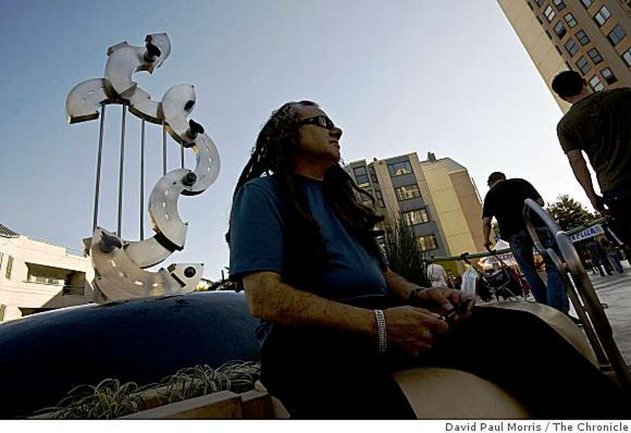 "Ricardo Reyes of San Francisco sits by the ""Hard Bop"" sculpture by artist John Atkin at the newly dedicated Fillmore Center Plaza October 25, 2008 in San Francisco, California.  Photograph by David Paul Morris / The Chronicle Photo: David Paul Morris, The Chronicle"