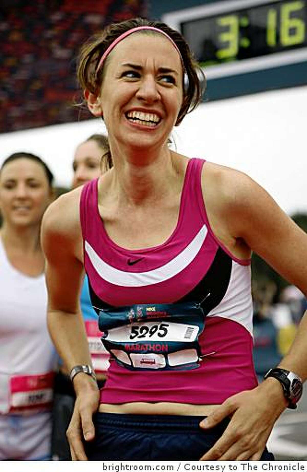 Arien O'Connell crosses the finish line at the Nike's Woman Marathon on Sunday, October 19, 2008 in San Francisco, Calif.
