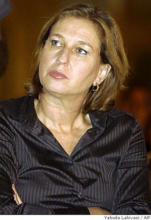 Israeli Foreign Minister and Kadima Party leader Tzipi Livni is seen during a meeting with students in Ayaleem, southern Israel, Thursday, Oct. 23, 2008. Israel's Prime Minister-designate Livni has set an ultimatum: Either she will have a new government ready by Sunday or call she will call for early elections. Livni said Thursday that she had spoken with Israeli President Shimon Peres and informed him of her decision. (AP Photo/Yehuda Lahiyani) ** ISRAEL OUT ** Photo: Yehuda Lahiyani, AP