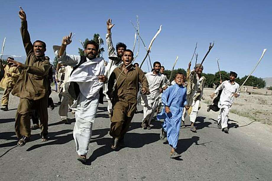 Local residents take out a procession as they accuse NATO forces of killing civilians in an overnight raid, at Surkh Rod, Afghanistan, Friday, May 14, 2010. More than 500 people poured into the streets in the Surkh Rod district of Nangahar province to protest the raid by international forces that they claim killed at least nine civilians. Photo: Rahmat Gul, AP