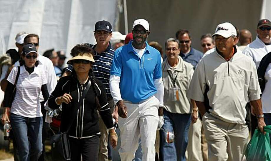 Former 49er great Jerry Rice walks to the first tee followed by the largest gallery at the Nationwide Tour golf event Thursday April 15, 2010. The Fresh Express Classic being played at Stonebrae Country Club in Hayward Ca runs through Sunday. Photo: Lance Iversen, The Chronicle