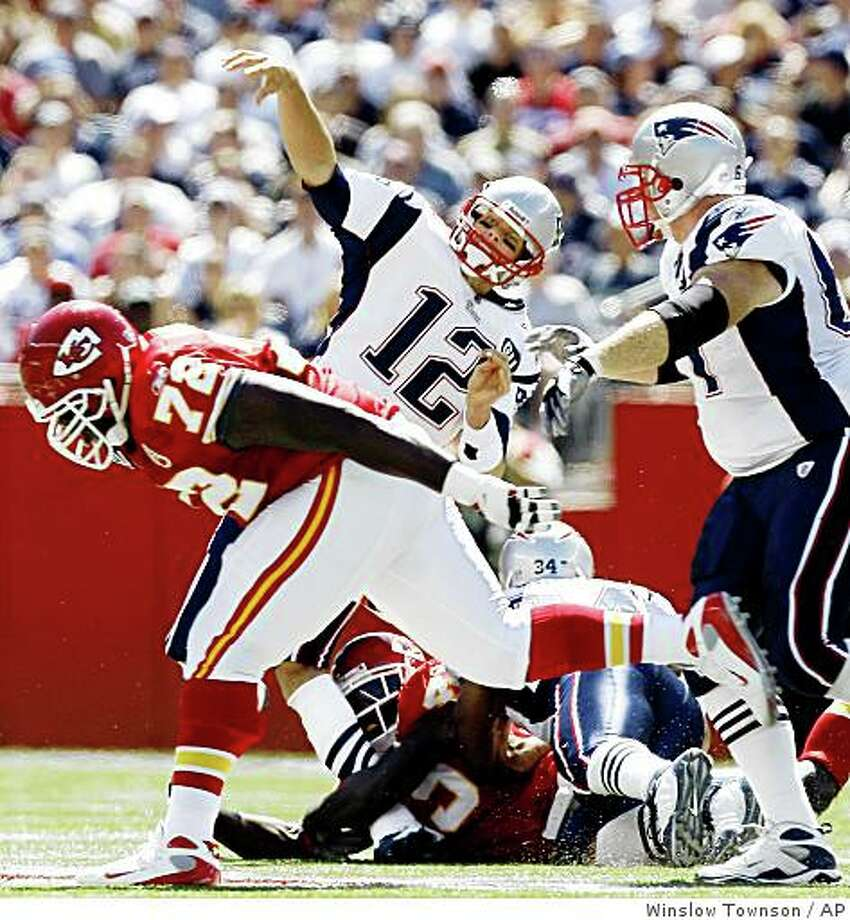New England Patriots quarterback Tom Brady (12) has his leg buckled by Kansas City Chiefs safety Bernard Pollard, bottom, during the first quarter of an NFL football game at Gillette Stadium in Foxborough, Mass., Sunday, Sept. 7, 2008. Brady left the game and was taken to the locker room. (AP Photo/Winslow Townson) Photo: Winslow Townson, AP