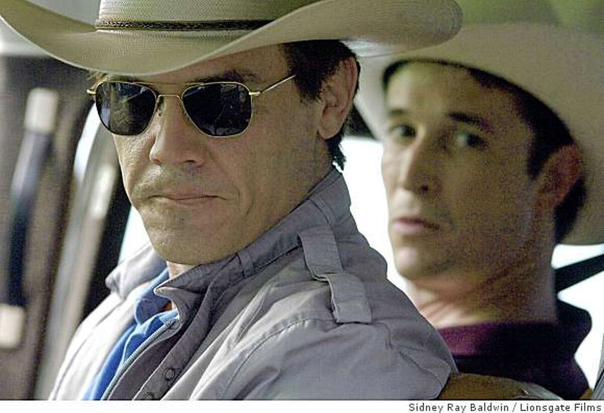 """Actors Josh Brolin (L) and Noah Wyle act in the movie """"W"""" as seen in this handout image released to Reuters October 10, 2008. Oliver Stone's film portrait of U.S. President George W. Bush was always going to be controversial given the director's liberal leanings, so he decided to open """"W."""" in U.S. theaters less than three weeks before Americans select their next president -- a calculated move aimed at prodding voters to think about the past eight years and the future."""