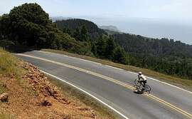 A cyclist races down from the summit at Mount Tamalpais State Park Wednesday, May 12, 2010.