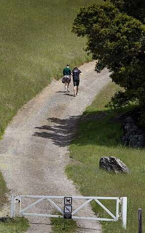 A couple walks past a locked gate at Mount Tamalpais State Park, Rock Spring area Wednesday, May 12, 2010. Photo: Lance Iversen, The Chronicle