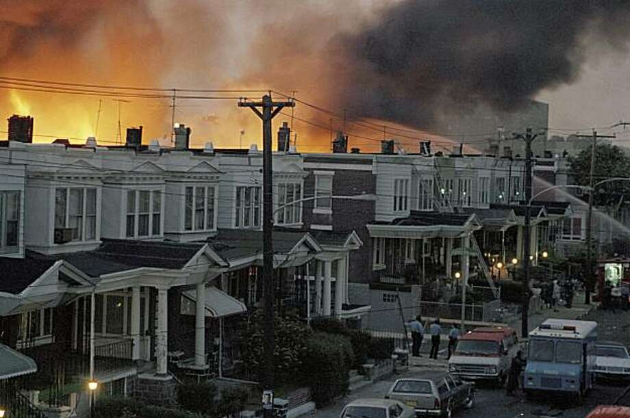 FILE - In this  May, 1985 file photo, scores of row houses burn in a fire in the west Philadelphia neighborhood. Police dropped a bomb on the militant group MOVE's home on May 13, 1985 in an attempt to arrest members, leading to the burning of scores of homes in the neighborhood. Photo: AP