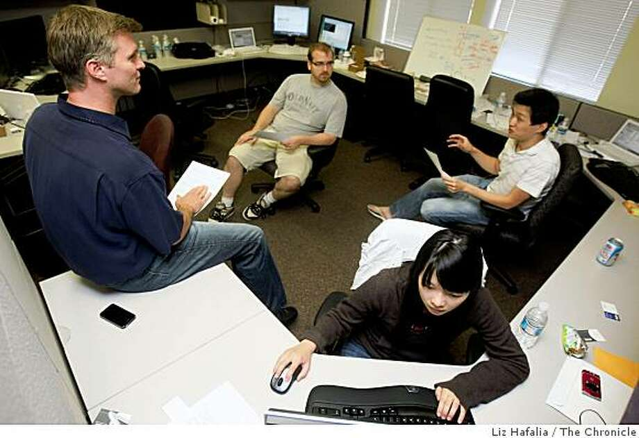 Founder Doug Renert  (far left) of Tandem Entrepreneurs, helping to launch a new startup, ZumoDrive, in San Mateo, Calif., on Tuesday, September 16, 2008.  Clockwise from top are crew from ZumoDrive, a startup making media available anywhere--Founder Kevin West, founder and CEO David Zhao, and designer Joyce Chen. Photo: Liz Hafalia, The Chronicle
