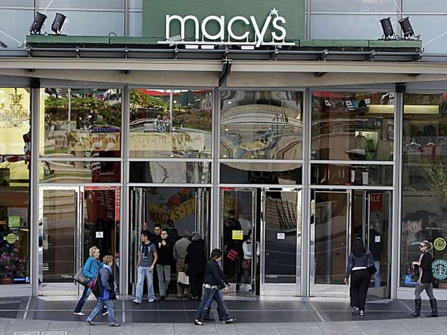 In this April 1, 2010 photo, shoppers enter exit Macy's in San Francisco. Consumer spending rose in March by the largest amount in five months but the gains were financed out of savings, which fell to the lowest level in 18 months. Photo: Marcio Jose Sanchez, AP