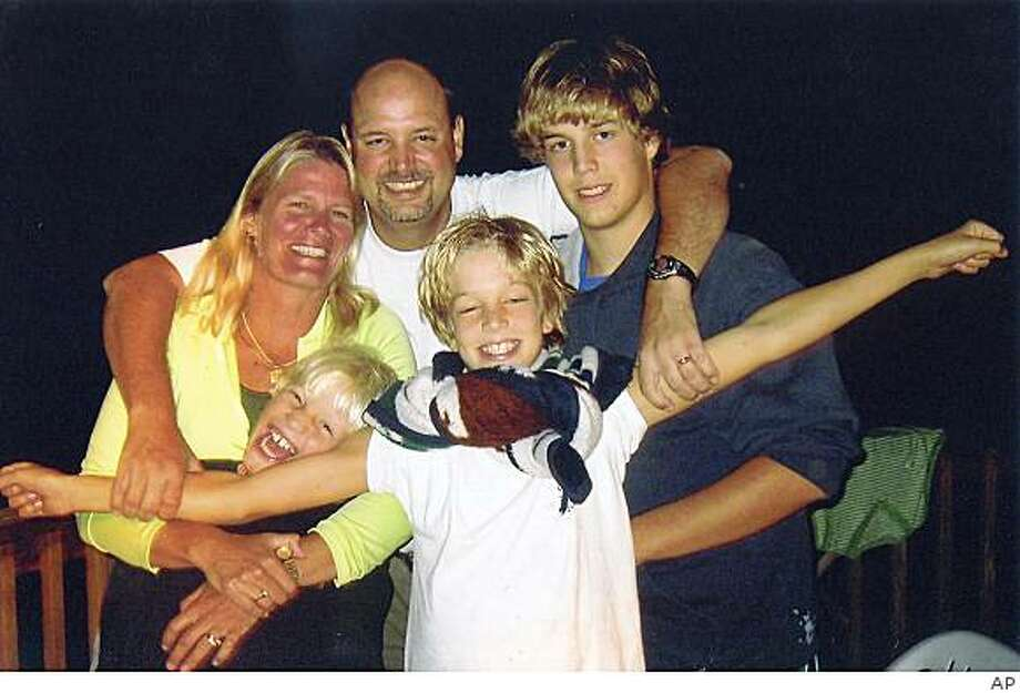 ** FILE ** In this undated file photo originally provided by the Browning family, Tamara, left, and John Browning, center, are shown with their children Nicholas, top right, Benjamin, left, and Gregory, right.  Nicholas Browning pleaded guilty in court Monday Oct. 27, 2008, to the murders of his father, mother and two younger brothers. In exchange for the plea,  prosecutors will not seek a sentence of life without parole. (AP Photo/Browning Family) Photo: AP