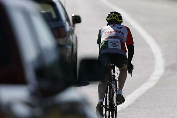 A cyclist, despite being in a bike lane is still very vulnerable to traffic on Sand Hill Road in Menlo Park, Calif. Photo taken on March 20, 2008. Photo by Michael Maloney / San Francisco Chronicle